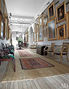 At Dumfries House in Scotland, which was published in Architectural Digest, portraits fill the walls of a skylit gallery, which contains cockpen chairs (possibly by Chippendale) as well as Louis XVI–style gilt-wood armchairs by R. Whytock & Co.; traditional rush matting is scattered with small rugs.