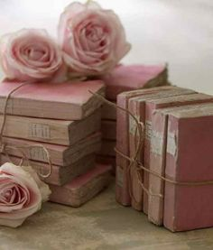 """pink vintage books. Love using books that aren't strong enough for reading as decor. We could rescue """"dying"""" books and use their pages as well"""