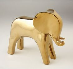 This modern elephant sculpture is perfect for a chic display, from the mantel to a kids room. Designed by Dwell Studio, these animal sculptures are inspired by an era of glamorous Safari expeditions, circa 1900.  FINISH: Ceramic with electroplated glaze.  [share]