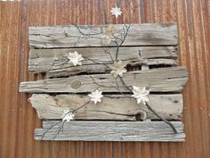 distressed rustic local barnwood wall hanging. Inspiration - lovely in a rustic style room, consider outdoors as well, (this costs 120.00 at Etsy it's beautiful, but at that price, my old barn would be worth about 100K)