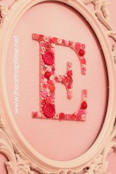 framed wall letters with buttons- so fun for little girl's bedroom!