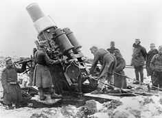 Austro-Hungarian 305mm Skoda howitzer and crew in action against the Russian Imperial Army in the Carpathian Mountains, November-December, 1914.