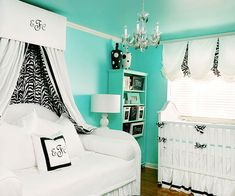 Double-Duty Success!  This high contrast turquoise, white and black baby girl's nursery features unique storage and a place for mom to rest as well!