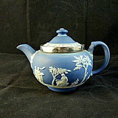 Wedgwood Blue Jasperware Teapot, Sterling Silver Rim. Click on the image for more information.
