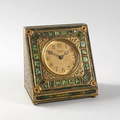 A Tiffany Studios New York gilt bronze and enamel clock, found at Macklowe Gallery