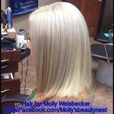 Platinum white blonde hair.