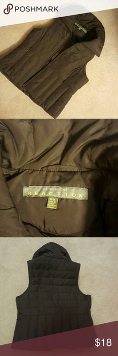 Kenneth Cole Reaction Brown Down Vest Size Medium.  Filler is 60% down 40% feathers.  She'll and lining are polyester.  Great condition.  Brown. Kenneth Cole Reaction Jackets & Coats Vests