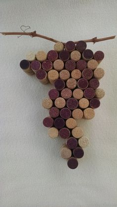 Grape Cluster for Wall or counter display made from wine corks. The corks are naturally colored in the bottle and placed for design. Grape vine stem attached. There is a wall hook for hanging placed on the back. Created in a non-smoking home wood shop by an experienced woodworker.