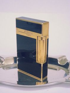 100 % AUTHENTIC  S. T. DUPONT LIGHTER ~ 18 K GOLD PLATE TRIM WITH BLACK LACQUER de CHINE  PLEASE SEE ALL PICTURES FOR CONDITION. ALL SALES