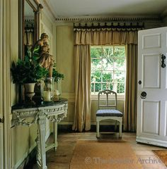 Nicky Haslam ~ The entrance hall of the Tudor property has a castellated curtain pelmet which was designed by John Fowler