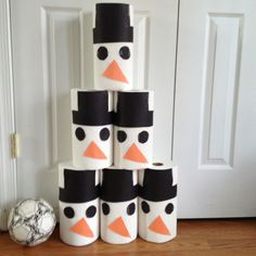 Snowman bowling for kid holiday party. Paper towel rolls and construction paper.