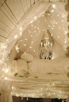 Fairy Tale bedroom. Looks so sweet and cozy. Love the little lights