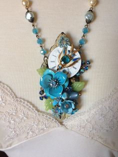 Bluebird in Flight...Here is an upcycled necklace made from a repurposed vintage butterfly hinge, vintage white porcelain watch face, and