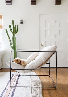Inside Interior Designer Genna Margolis' Light, Bright Rental - Home Tour - Lonny A fresh lick of paint can make all the difference. Steel Furniture, Diy Furniture, Furniture Design, Poltrona Design, Pottery Barn Sofa, White Fireplace, Chair Design, Vintage Rugs, Interior Decorating