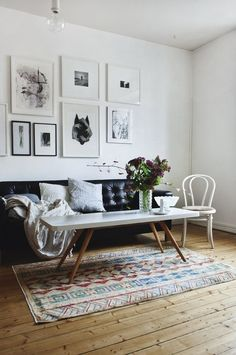 tribal rug, wood floors, black and white art