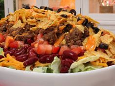 Stacked Taco Salad - Impress everyone this summer with a Mexican party recipe that's simply jaw-dropping. Our Stacked Taco Salad is absolutely bursting with flavor.