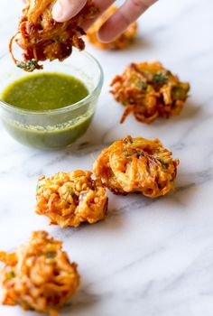 Authentic recipe for deep-fried onion pakora. Deliciously spiced Indian fritters are served accompanied by mint-cilantro chutney. Great as an appetizer.