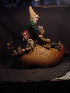 "Winkin', Blinkin', and Nod, one night sailed off in a wooden shoe; Sailed off on a river of crystal light into a sea of dew.""  17"" high and 17"" long, a real hand carved antique Dutch Shoe and our Gnomes.   Just finished.  Norma and David DeCamp 2/12/14"