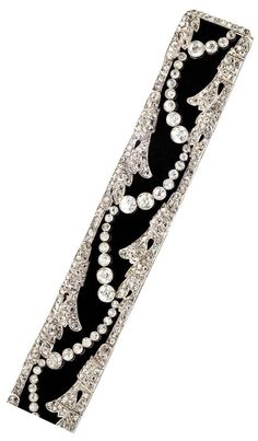 An Art Deco Diamond, Platinum and Velvet Choker/Bracelet, circa 1925. The choker set with old mine- and European-cut diamonds, weighing a total of approximately 19 carats, mounted in platinum on a black velvet ribbon.