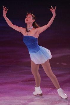 Pretty ice skater in blue