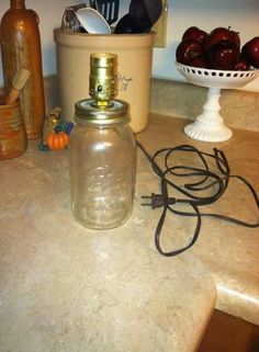 I love this! Create a mason jar lamp! #DIY #masonjars #udderlysmooth