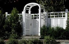 A nice white vinyl fence and gate.