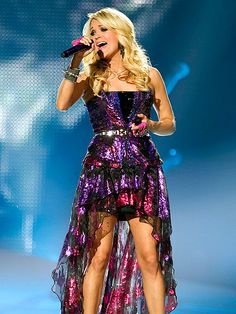 Carrie Underwood brings glitz and glam to the Mandalay Bay Hotel & Casino in Las Vegas, where the country star took the stage as part of her Blown Away tour. http://www.people.com/people/gallery/0,,20678682,00.html