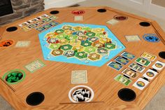 Settlement Series Table in Oak - SKU: SSO-01  The Official Settlers of Catan table is here! Built for the most avid players or for the families joined together on game night. Place the table top on (secured by flush magnets) when playing other games to use it as an all-around game table.  The Settlement Series offers gamers to use the original Settlers of Catan board game, 5-6 player extension and Cities and Knights expansion pack.   This is awesome!!