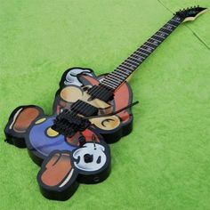 Super Mario guitar by Geekd. This unique Super Mario guitar is hand crafted to get it own unique look and individual personality. Read more about Mario Electric Guitar. Guitar Pics, Music Guitar, Cool Guitar, Playing Guitar, Easy Guitar, Super Mario Bros, Custom Electric Guitars, Custom Guitars, Geeks
