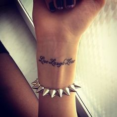 live laugh love tattoo- this is what I was told wouldn't fit on my wrist!! Feckers