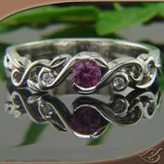 Pretty Pink Sapphire Organic Pierced Mounting. Click to see the men's band that goes with this ring. The tree detail is beautiful. #Engagement by #Jewelryworks