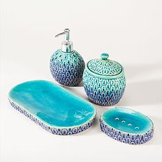 Peacock Bath Accessories  $6.99 to $9.99  Turn your bathroom into an escape with our exclusive Peacock Bath Accessories. Coordinating countertop pieces are crafted of stoneware and feature a geometric motif with an ombre design of exotic colors resembling those found on peacock feathers.