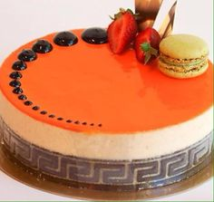 A fabulous cake by Aroma Bake House topped with fresh fruit and a macaron