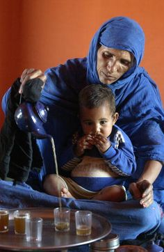 Bedouin Family, Western Sahara - this is the way I remember tea being made in Guinea, south of the Sahara, in this type of teapot, and using this type of glasses.
