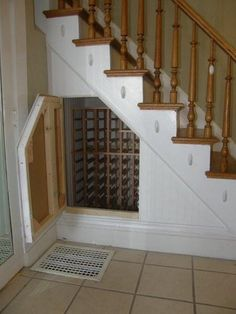 Wine storage under stairs. What a great idea! Out of sight for those who don't care to know just how much wine we put away :) and lockable for kids