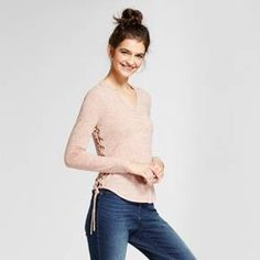 Your go-to basic just got an upgrade — elevate your style with this Long-Sleeve Lace-Up Sides T-Shirt by Mossimo Supply Co.™ The long-sleeve V-neck tee brings an edgy twist with tie-up details on the side. Wear this elevated basic with your favorite pair of jeans for a stylish look you can wear anywhere.