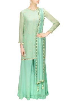 turquoise silk chiffon kurta with pearl embroidered jaal motifs scattered all over it. It has pearl embroidered buttoned cuffs. It is paired with matching bias cut pants in silk chiffon and turquoise dupatta with embroidered scalloped border all around it.