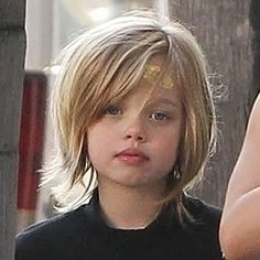 2013 Shiloh's tresses grew into a chic layered bob. At seven years old, she looks more like mother Angelina every day.
