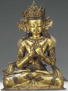 16th-17th century, Nepal, unidentified bodhisattva, gilt copper repoussé inlaid with stones, private collection