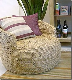 Upcycled tire chair. Wrapping tire chairs in rope sure does make them look nice.