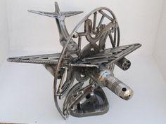 Circle metal sculpture handmade by Giannis Dendrinos Science Fiction Art, Circle Shape, Spaceship, Sculptures, Metal, Robot, Artist, Handmade, Ideas