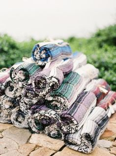 Mexican blankets for guests on a chilly wedding day - photo by Erich McVey