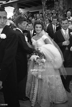 American future First Lady Jacqueline Kennedy (1929 - 1994) poses with her husband politician and future US President John F. Kennedy (1917 - 1963) immediately after their wedding at Hammerstein Farm Newport, Rhode Island, September 12, 1953.