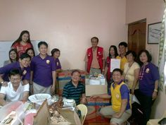 Turn Over of 2 Shoe Boxes of 7 Boxes Donated by Calgary Filipino Lions Club to Philippine Lions Street Children Foundation thru Q C Cubao Lions Club