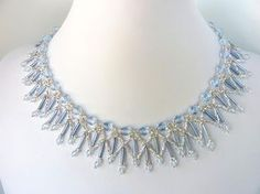 Free beading pattern for lovely ice blue crystal necklace, resembling frozen icicles, made with round crystals, bugle beads, and seed beads.