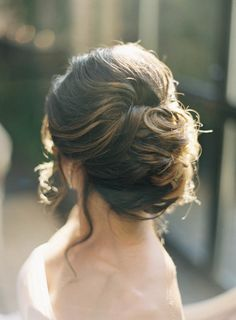 Bride's hairstyle, romantic messy #bun Discover how Vênsette can craft custom beauty looks for your special moment: http://vensette.com/bridal_inquiries