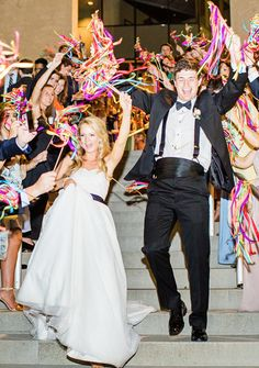 DIY Creative and Colorful Ribbon Wand Exit | Mint Museum Uptown Charlotte Wedding Reception Venue | Planning/design by North Carolina Wedding Planner Erica Stawick of Ashley Baber Weddings | Robyn Van Dyke Photography