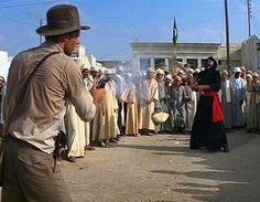 Indiana Jones: Raiders of the Lost Ark.  The original script called for a long sword fight but a day earlierFord got a severe case of food poisoning and didn't have the energy to film the scene as written. After a discussion with director Steven Spielberg, the scene was changed and became an iconicpart of Indiana Jonesmythos.
