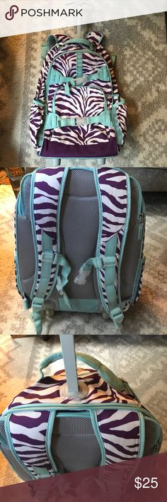 Pottery Barn Purple Zebra Rolling Backpack GUC- This has been through the airport more than a few times so it has some wear especially on the handles and latches, marker explosion on top compartment and small red spot at top pictured. Handle and zippers all work great. Pottery Barn Kids Accessories Bags