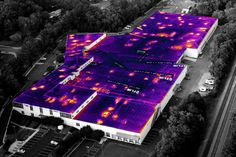 Rooftop infrared thermography inspection shows heat loss areas.
